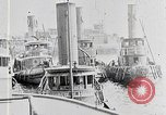 Image of New York Harbor and Brooklyn Bridge seen from steamship New York City USA, 1917, second 4 stock footage video 65675025400