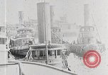 Image of New York Harbor and Brooklyn Bridge seen from steamship New York City USA, 1917, second 5 stock footage video 65675025400