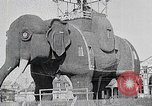 Image of giant wooden elephant with skin of hammered tin Margate New Jersey USA, 1919, second 2 stock footage video 65675025408