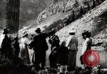 Image of City people mountain climbing Western United States USA, 1919, second 2 stock footage video 65675025422