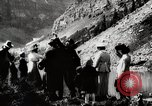 Image of City people mountain climbing Western United States USA, 1919, second 3 stock footage video 65675025422