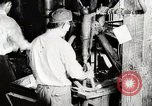 Image of Car wheel manufacturing assembly line Detroit Michigan USA, 1919, second 2 stock footage video 65675025427