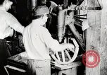 Image of Car wheel manufacturing assembly line Detroit Michigan USA, 1919, second 3 stock footage video 65675025427
