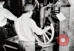 Image of Car wheel manufacturing assembly line Detroit Michigan USA, 1919, second 4 stock footage video 65675025427