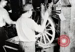 Image of Car wheel manufacturing assembly line Detroit Michigan USA, 1919, second 5 stock footage video 65675025427