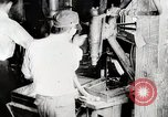 Image of Car wheel manufacturing assembly line Detroit Michigan USA, 1919, second 7 stock footage video 65675025427