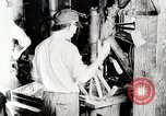 Image of Car wheel manufacturing assembly line Detroit Michigan USA, 1919, second 9 stock footage video 65675025427