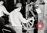 Image of Car wheel manufacturing assembly line Detroit Michigan USA, 1919, second 10 stock footage video 65675025427
