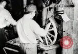 Image of Car wheel manufacturing assembly line Detroit Michigan USA, 1919, second 11 stock footage video 65675025427