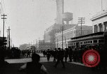 Image of Busy market street near Ford Factory Michigan United States USA, 1926, second 10 stock footage video 65675025428