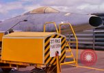 Image of Airman paints F100D plane Phu Cat Vietnam, 1968, second 2 stock footage video 65675025448