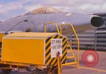 Image of Airman paints F100D plane Phu Cat Vietnam, 1968, second 3 stock footage video 65675025448