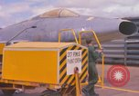 Image of Airman paints F100D plane Phu Cat Vietnam, 1968, second 5 stock footage video 65675025448
