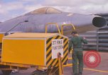 Image of Airman paints F100D plane Phu Cat Vietnam, 1968, second 7 stock footage video 65675025448