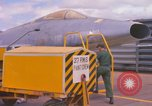 Image of Airman paints F100D plane Phu Cat Vietnam, 1968, second 8 stock footage video 65675025448