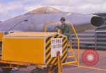 Image of Airman paints F100D plane Phu Cat Vietnam, 1968, second 9 stock footage video 65675025448