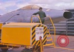 Image of Airman paints F100D plane Phu Cat Vietnam, 1968, second 10 stock footage video 65675025448