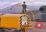 Image of Airman paints F100D plane Phu Cat Vietnam, 1968, second 11 stock footage video 65675025448