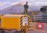 Image of Airman paints F100D plane Phu Cat Vietnam, 1968, second 12 stock footage video 65675025448