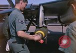 Image of United States Air Force airmen fuse 500 lb GP bombs Phu Cat Vietnam, 1968, second 5 stock footage video 65675025450