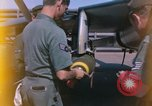 Image of United States Air Force airmen fuse 500 lb GP bombs Phu Cat Vietnam, 1968, second 6 stock footage video 65675025450