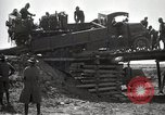 Image of U.S. Army convoy truck breaks through wooden bridge Wyoming United States USA, 1919, second 3 stock footage video 65675025554