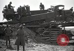 Image of U.S. Army convoy truck breaks through wooden bridge Wyoming United States USA, 1919, second 7 stock footage video 65675025554