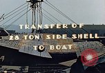 Image of A moving crane transferring a 28 ton steel side shell for Liberty ship California United States USA, 1942, second 5 stock footage video 65675025790