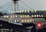 Image of A moving crane transferring a 28 ton steel side shell for Liberty ship California United States USA, 1942, second 6 stock footage video 65675025790