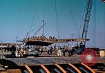 Image of A moving crane transferring a 28 ton steel side shell for Liberty ship California United States USA, 1942, second 12 stock footage video 65675025790