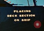 Image of Mobile cranes move ship's deck section at shipyard in World War California United States USA, 1942, second 1 stock footage video 65675025791