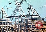 Image of Mobile cranes move ship's deck section at shipyard in World War California United States USA, 1942, second 10 stock footage video 65675025791