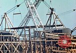 Image of Mobile cranes move ship's deck section at shipyard in World War California United States USA, 1942, second 11 stock footage video 65675025791