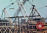 Image of Mobile cranes move ship's deck section at shipyard in World War California United States USA, 1942, second 12 stock footage video 65675025791