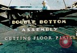 Image of Fabrication and installation of floor plates on double bottom of ship California United States USA, 1942, second 1 stock footage video 65675025799