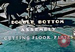 Image of Fabrication and installation of floor plates on double bottom of ship California United States USA, 1942, second 2 stock footage video 65675025799