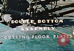 Image of Fabrication and installation of floor plates on double bottom of ship California United States USA, 1942, second 6 stock footage video 65675025799