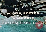 Image of Fabrication and installation of floor plates on double bottom of ship California United States USA, 1942, second 8 stock footage video 65675025799