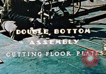 Image of Fabrication and installation of floor plates on double bottom of ship California United States USA, 1942, second 9 stock footage video 65675025799