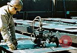 Image of Fabrication and installation of floor plates on double bottom of ship California United States USA, 1942, second 11 stock footage video 65675025799