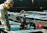 Image of Fabrication and installation of floor plates on double bottom of ship California United States USA, 1942, second 12 stock footage video 65675025799