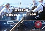 Image of Welders install piping in double bottom of Liberty ship in World War 2 California United States USA, 1942, second 8 stock footage video 65675025802