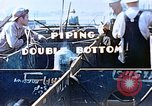 Image of Welders install piping in double bottom of Liberty ship in World War 2 California United States USA, 1942, second 10 stock footage video 65675025802