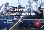 Image of Welders install piping in double bottom of Liberty ship in World War 2 California United States USA, 1942, second 11 stock footage video 65675025802