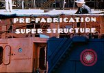 Image of Shipyard workers prefabricating Liberty Ship superstructure California United States USA, 1942, second 1 stock footage video 65675025803