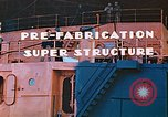 Image of Shipyard workers prefabricating Liberty Ship superstructure California United States USA, 1942, second 5 stock footage video 65675025803