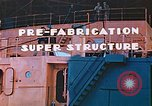 Image of Shipyard workers prefabricating Liberty Ship superstructure California United States USA, 1942, second 8 stock footage video 65675025803