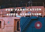 Image of Shipyard workers prefabricating Liberty Ship superstructure California United States USA, 1942, second 10 stock footage video 65675025803
