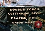 Image of Double torch cutting deck plates for Liberty ship under construction California United States USA, 1942, second 1 stock footage video 65675025804