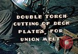 Image of Double torch cutting deck plates for Liberty ship under construction California United States USA, 1942, second 2 stock footage video 65675025804